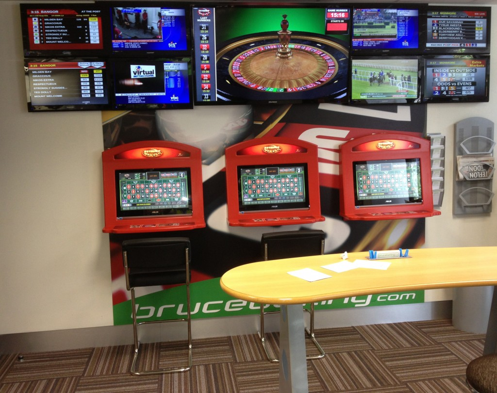 Bruce Betting fit out, with customer touch screen terminals panel
