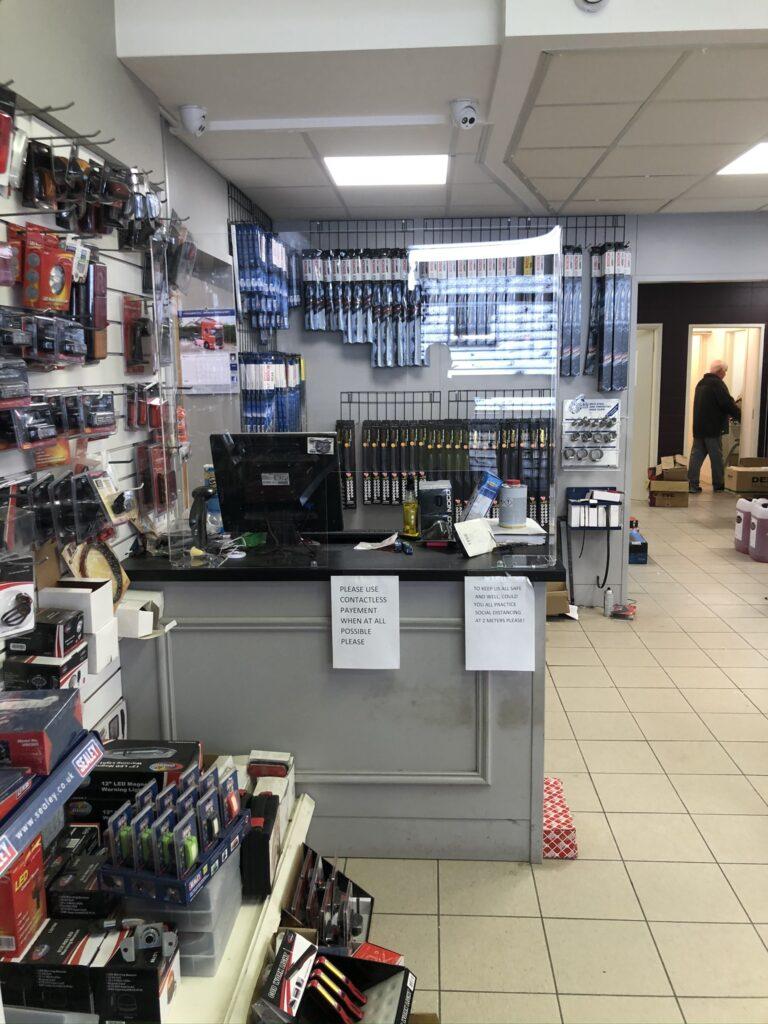 Image of Sneeze guard installed in Motor factors store in Ireland